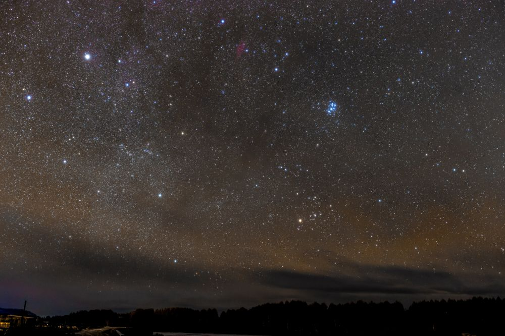 Star sky through clouds